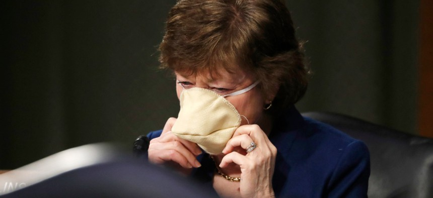 Sen. Susan Collins, R-Maine, arrives at a Senate Intelligence Committee nomination hearing for Rep. John Ratcliffe, R-Texas,  to be intelligence director. Collins was a lead author of the letter.