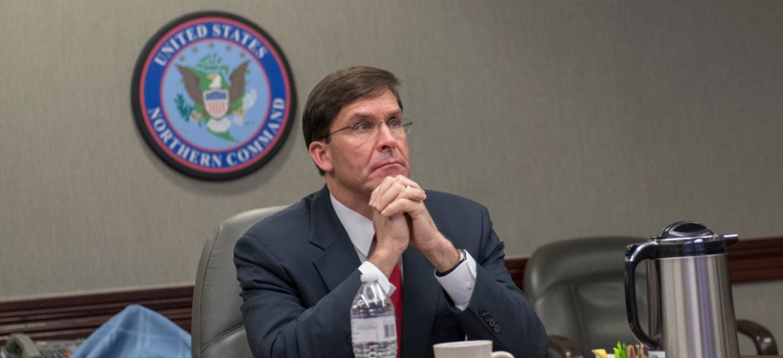 Defense Secretary Mark Esper receives a COVID-19 briefing from Gen. Terrence J. O'Shaughnessy, commander of North American Aerospace Defense Command and U.S. Northern Command, on May 7.