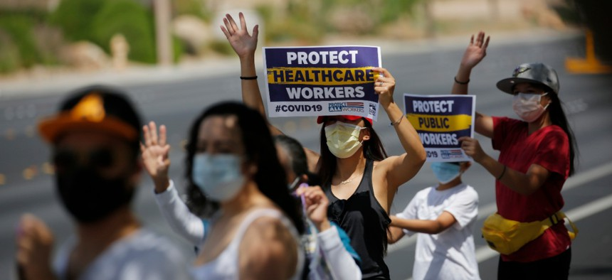 Health care workers protest what they say are unsafe working conditions outside of MountainView hospital in Las Vegas on April 30, and demand that OSHA intervene.