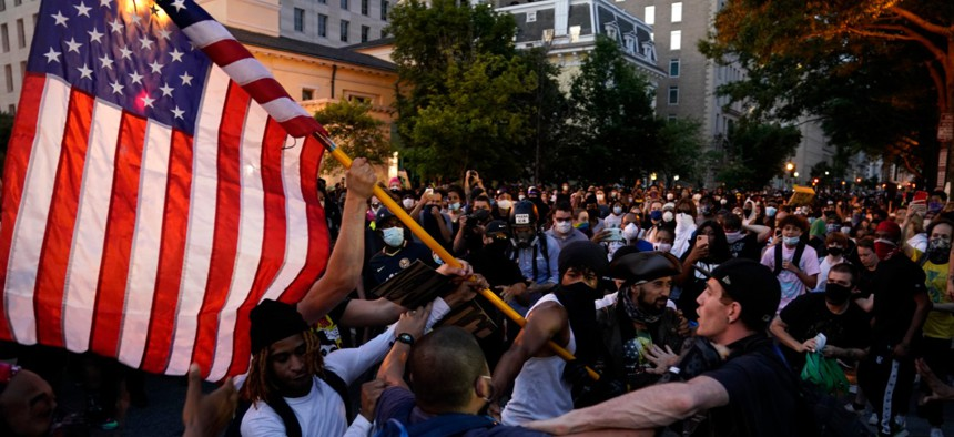 Demonstrators clash as people gather to protest the death of George Floyd, Saturday, May 30, 2020, near the White House.