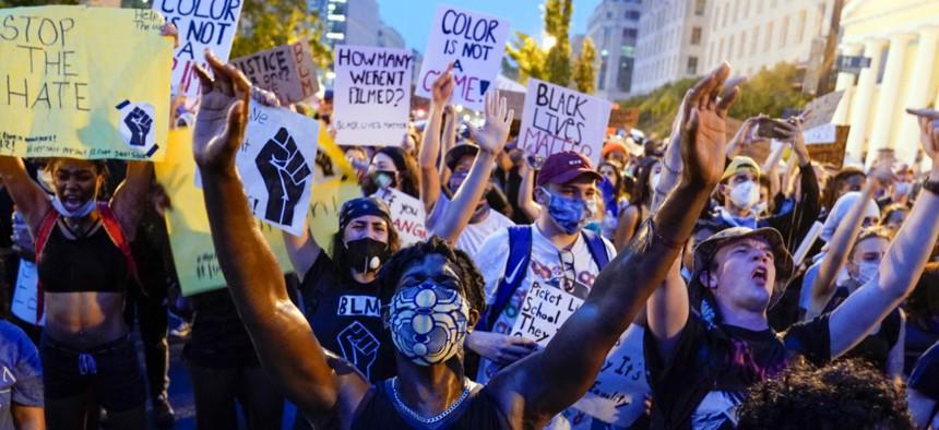 Demonstrators protest, Thursday, June 4, near the White House in Washington.