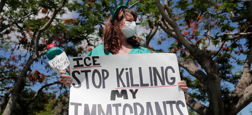 Laurie Woodward Garcia protests conditions at detention centers outside of an Immigration and Customs Enforcement field office during the new coronavirus pandemic on May 29 in Plantation, Fla.