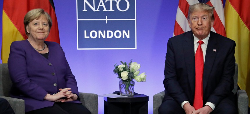 President Trump meets German Chancellor Angela Merkel during a NATO leaders meeting at The Grove hotel and resort in Watford, Hertfordshire, England, on Dec. 4, 2019.