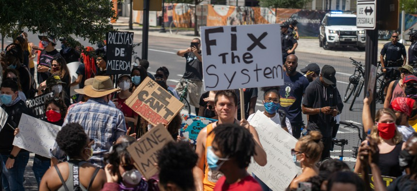 Orlando, Florida – May 30, 2020: Protesters gathered in downtown Orlando to show support for George Floyd, who died in police custody in Minneapolis, sparking nationwide protests.