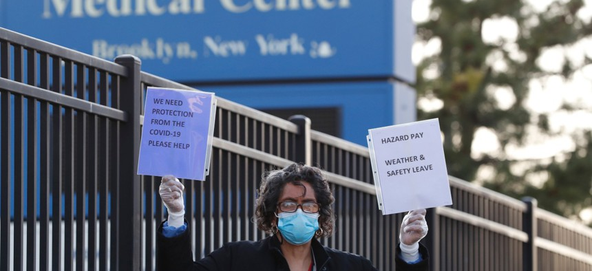 Susana Scott joins and other registered nurses and support staff outside the Brooklyn Veterans Administration Medical Center on April 6, where they called for more personal protective equipment and staffing assistance.