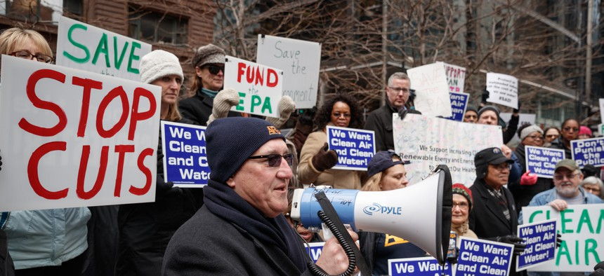 AFGE Local 704 union President Michael Mikulka speaks as Environmental Protection Agency workers protest job cuts during rally in Chicago, Illinois, March 2, 2017.