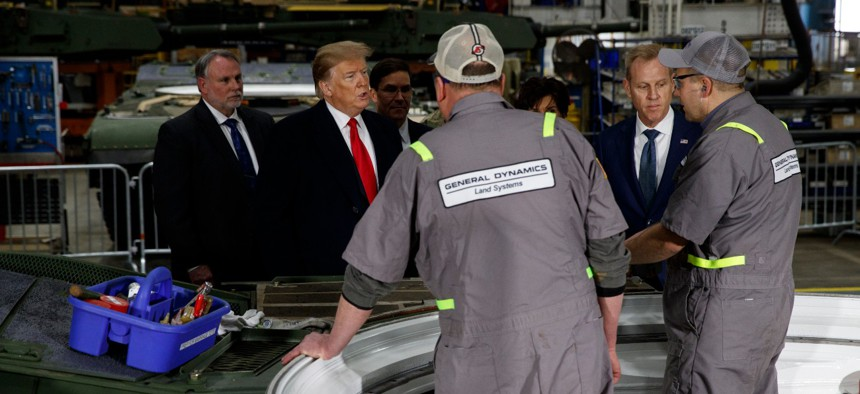 President Trump speaks with workers during a tour of the Lima Army Tank Plant in March 2019 in Lima, Ohio.