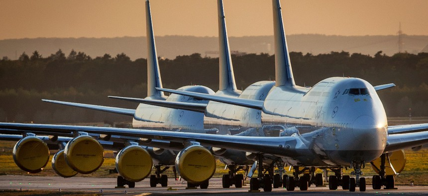 Lufthansa Boeing 747 aircrafts are parked at the airport in Frankfurt, Germany.