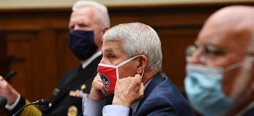 Dr. Anthony Fauci (center), Dr. Robert Redfield (right) and Adm. Brett Giroir testify during a House Subcommittee hearing on the coronavirus crisis on Friday, July 31.
