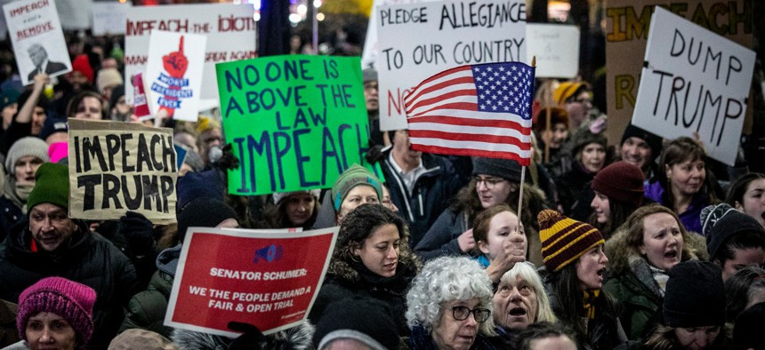 An anti-President Trump crowd gathers at a rally in New York to protest and call for his impeachment in December 2019.