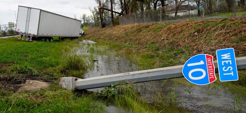 A truck and Interstate 10 sign is seen on Thursday in Lake Charles, La., after Hurricane Laura moved through the state