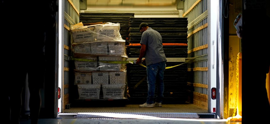 Absentee ballots are loaded onto a truck for mailing at the Wake County Board of Elections as preparation for the upcoming election are ongoing in Raleigh, N.C., Thursday, Sept. 3, 2020.