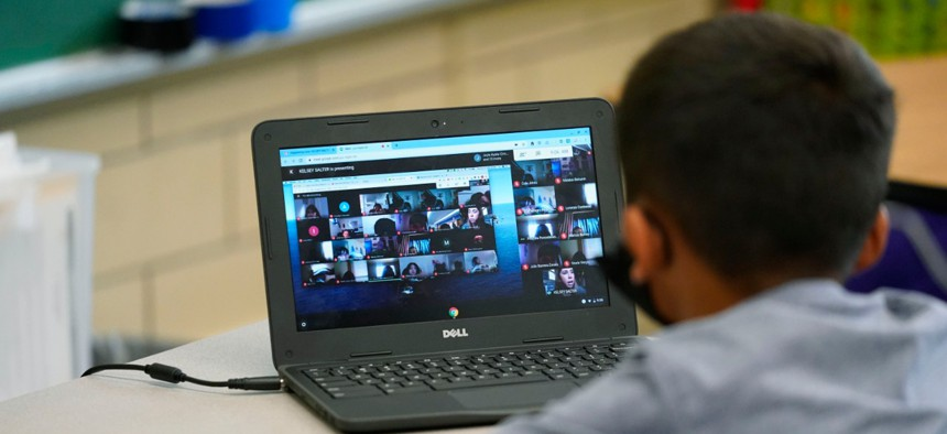A student works on a laptop in a classroom at a school in Denver in August.