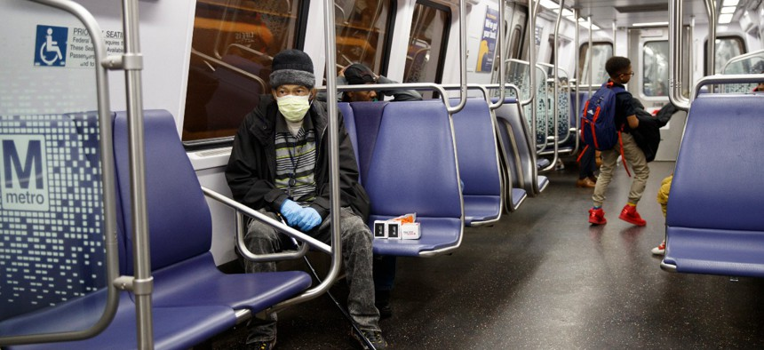 A mostly empty car on a Metro train in Washington, D.C., shown in March just after agencies started closing and moving to maximum telework.