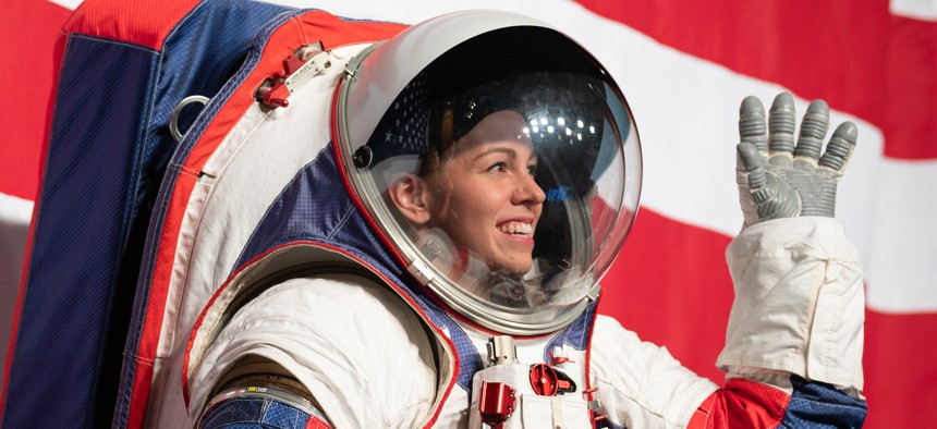 Kristine Davis, a spacesuit engineer at NASA's Johnson Space Center, wearing a ground prototype of NASA's new Exploration Extravehicular Mobility Unit, is seen during a demonstration of the suit in 2019.