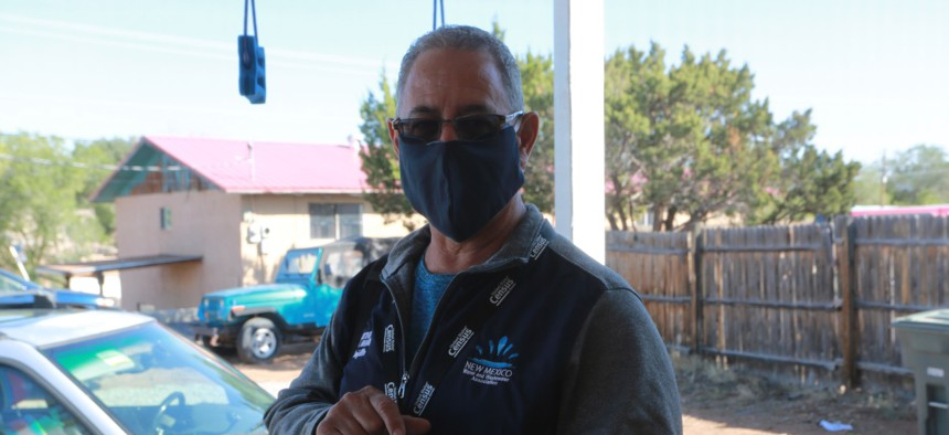 Census taker Paul Trujillo takes a headcount of residents at a home on Sept. 11 in Santa Fe, New Mexico.