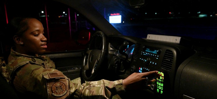 A defender from the 432nd Security Forces Squadron turns on a vehicle's red and blue lights during their night shift at Creech Air Force Base, Nevada, May 8, 2020.