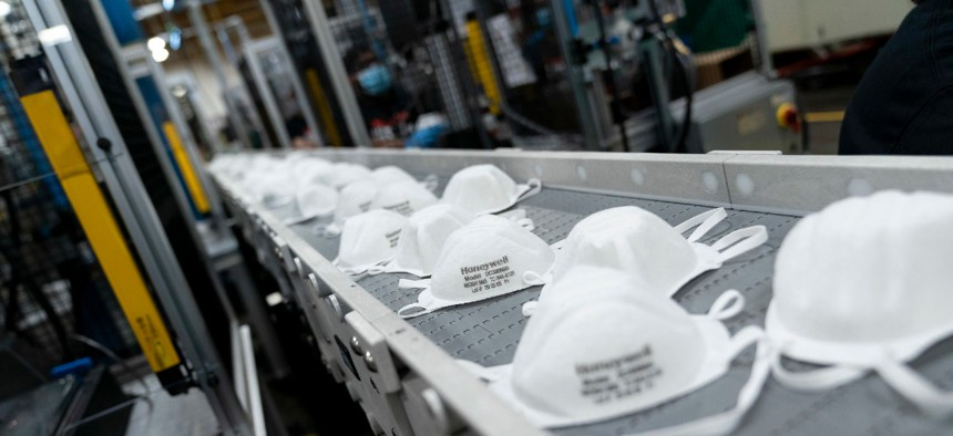 The mask production assembly line on May 5 at Honeywell International Inc. in Phoenix.