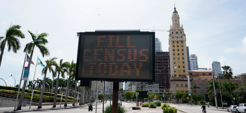 """A flashing sign near the iconic """"Freedom Tower,"""" advises people to fill out their census forms on Monday, Oct. 5, in downtown Miami."""