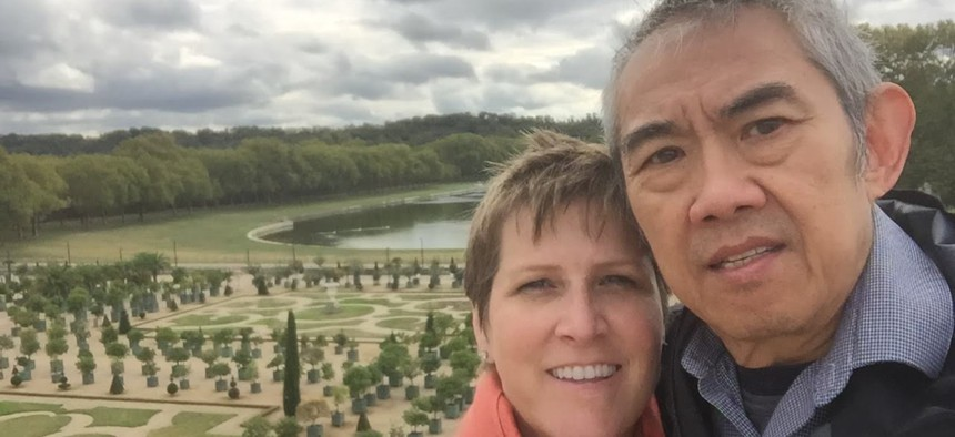 The author and her husband Chai Suthammanont on a trip to the gardens of Versailles