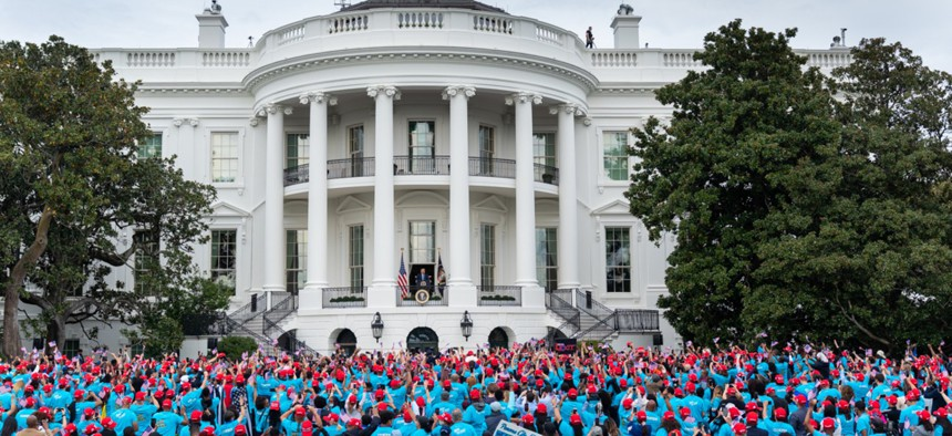 """President Trump addresses a """"law and order"""" rally of supporters at the White House on October 10."""