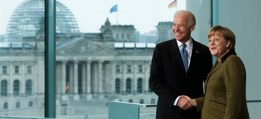 German Chancellor Angela Merkel, right, and United States' Vice President Joe Biden brief the media prior to a meeting at the chancellery in Berlin, Germany on Feb. 1, 2013.