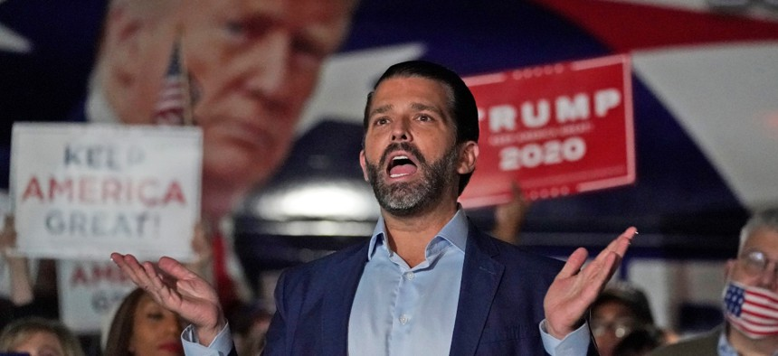 Donald Trump Jr. gestures during a news conference at Georgia Republican Party headquarters on Nov. 5 in Atlanta.