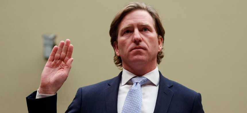 Department of Homeland Security Cybersecurity and Infrastructure Security Agency Director Christopher Krebs is sworn in on Capitol Hill to testify about election security on May 22, 2019.