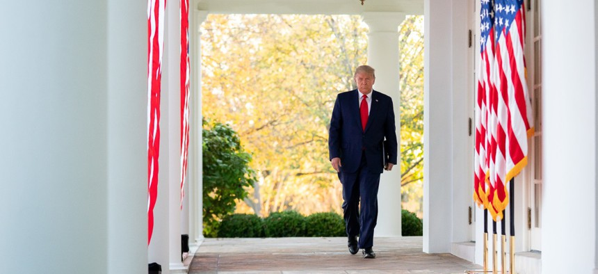 President Trump walks to a briefing in the White House Rose Garden on November 13, 2020.