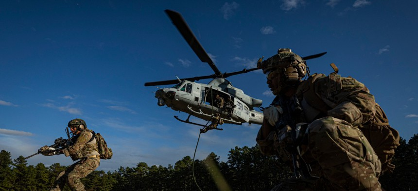 Special warfare airmen assigned to the New Jersey Air National Guard participate in fast-rope training with a Marine Corps UH-1Y Venom helicopter at Joint Base McGuire-Dix-Lakehurst, N.J., on Oct. 10, 2019.