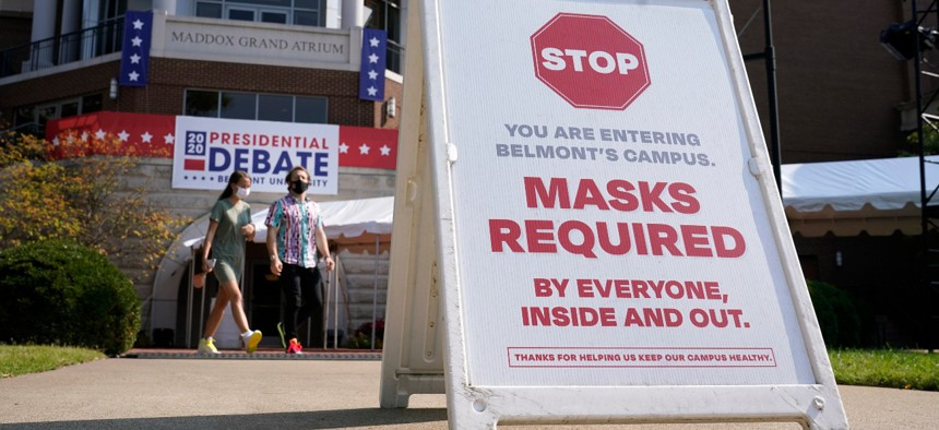 A sign greets visitors outside the Curb Event Center at Belmont University as preparations take place for the second Presidential debate on Oct. 20, 2020, in Nashville. President-elect Biden says he will require masks in federal buildings.