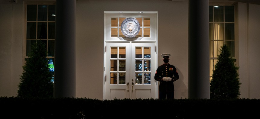 A Marine stands outside the entrance to the West Wing of the White House on November 10, 2020.