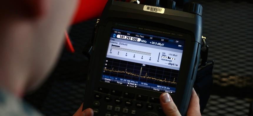 U.S. Air Force Staff Sgt. Geoffery Smith, 20th Communications Squadron installation spectrum manager, views the display on a radio spectrum analyzer at Shaw Air Force Base, S.C., on Jan. 13, 2017.