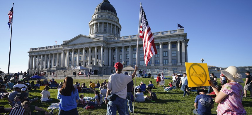 People gather during a rally during the summer against masks at the Utah capitol in Salt Lake City.