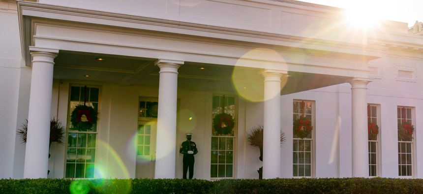 A Marine stands outside the entrance to the West Wing of the White House, signifying the President is in the Oval Office, Tuesday, Dec. 22, 2020.