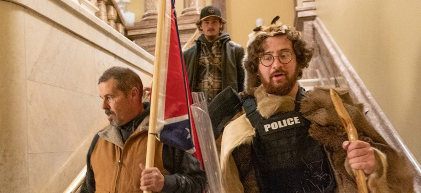 Supporters of President Trump walk down the stairs outside the Senate Chamber as violence erupted at the Capitol after demonstrators breached the security Wednesday.