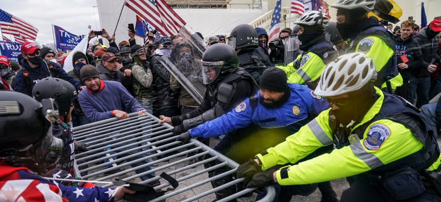 Trump supporters break through a police barrier, Wednesday, Jan. 6, 2021, at the Capitol in Washington.
