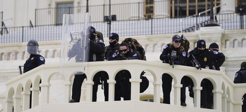 Police keep a watch, ... ]