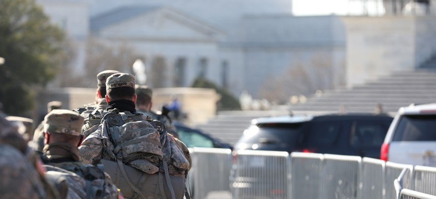U.S. Soldiers with the Virginia National Guard march near the U.S. Capitol building in Washington, D.C., Jan. 14.