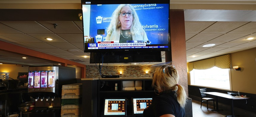 Waitress Lauren Musial watches a television briefing by Pennsylvania Health Secretary, Dr. Rachel Levine, at the Penrose Diner, Tuesday, Nov. 17, in South Philadelphia.