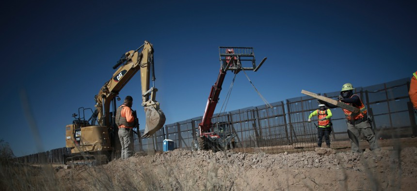 Workers prepare the foundation for a steel section of border wall that will be built on the Mexican side of older metal fencing dividing Ciudad Juarez, Mexico, from Sunland Park, New Mexico, on Jan. 12.