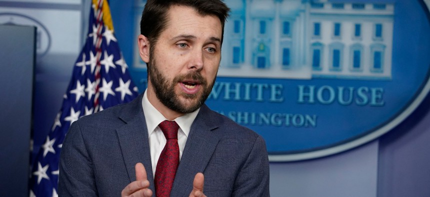 """National Economic Council Director Brian Deese speaks during a press briefing at the White House on Friday. Deese said federal contractors """"should be provided the benefits and pay that workers deserve."""""""