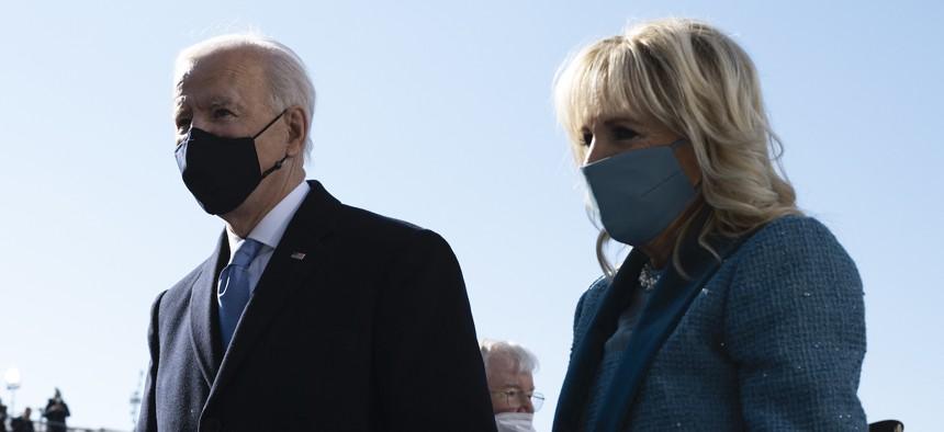 Joe and Jill Biden exit the inaugural platform on Jan. 20.