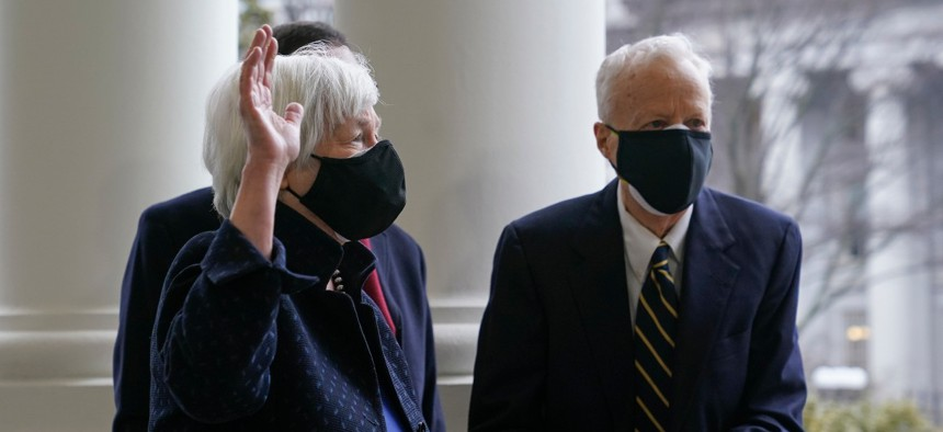 Treasury Secretary Janet Yellen, left, and Yellen's husband George Akerlof participate in a swearing-in ceremony on Tuesday at the White House.