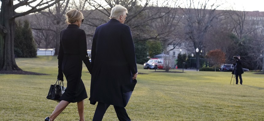 Donald and Melania Trump walk to board Marine One on the South Lawn of the White House on Jan. 20.