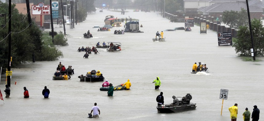Rescue boats float on a flooded street as people are evacuated from rising floodwaters brought on by Tropical Storm Harvey in Houston in August 2017.