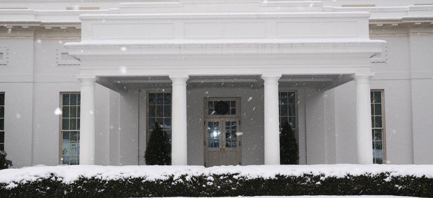 Snow falls on the ground on the West Wing of the White House, Tuesday, Feb. 2.