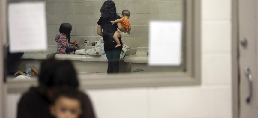 Detainees wait in a holding cell at a U.S. Customs and Border Protection processing facility in 2014 in Brownsville,Texas.