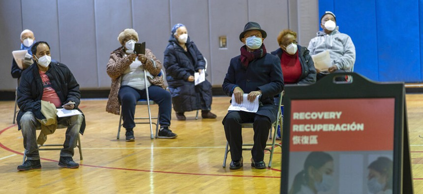 Seniors wait to be to register for the first dose of the coronavirus vaccine at a pop-up COVID-19 vaccination site at the Bronx River Community Center on Jan. 31.