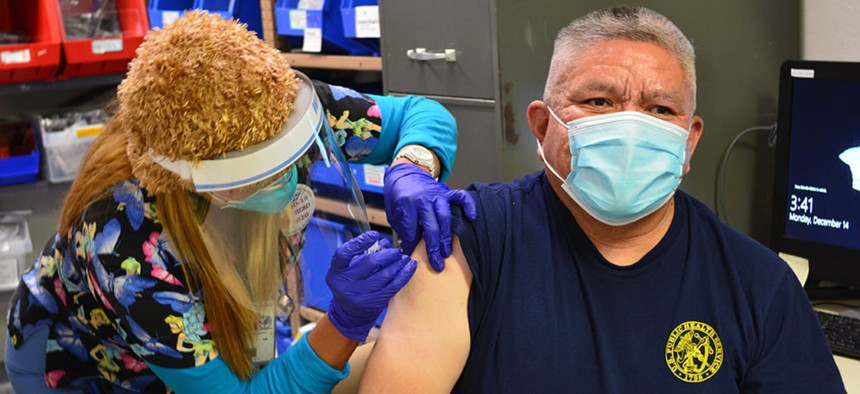 U.S. Public Health Service Capt. Jefferson Fredy, a member of the Navajo Nation and the chief of pharmacy at the Crownpoint Service Unit, was the second IHS employee to receive a COVID-19 vaccine on Dec. 14, 2020.